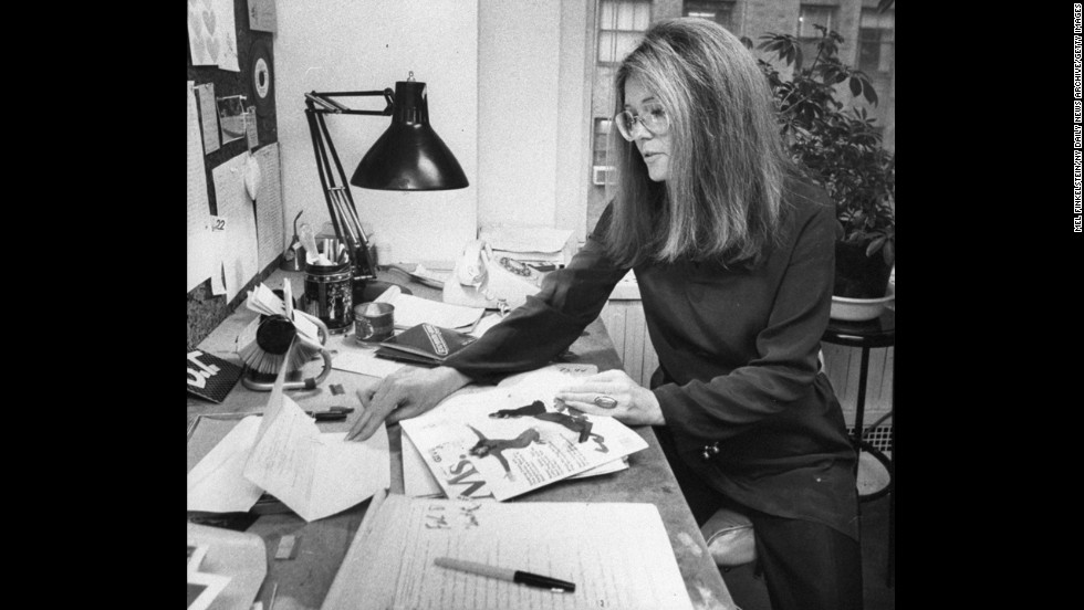 Steinem looks over a copy of Ms. magazine at her desk in 1980.
