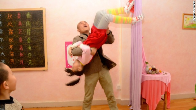 Headmaster Wei Yueling gets playful with his students.