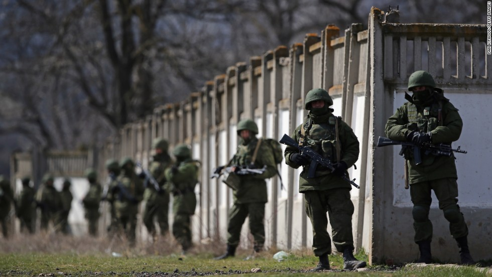 Russian military personnel surround a Ukrainian military base in Perevalne on March 19.