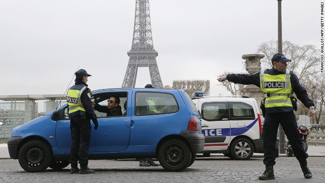Police check cars are conforming to the temporary ban as Paris attempts to improve its air quality.