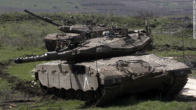 An Israeli tank is seen stationed near the village of Majdal Shams on the border with Syria, on March 19,2014 in the Israeli-annexed Golan Heights.