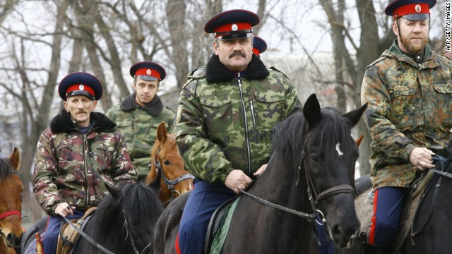 Mounted Cossacks patrol an area near Russian-Ukrainian border near the southern city of Rostov-on-Don, on March 19, 2014.