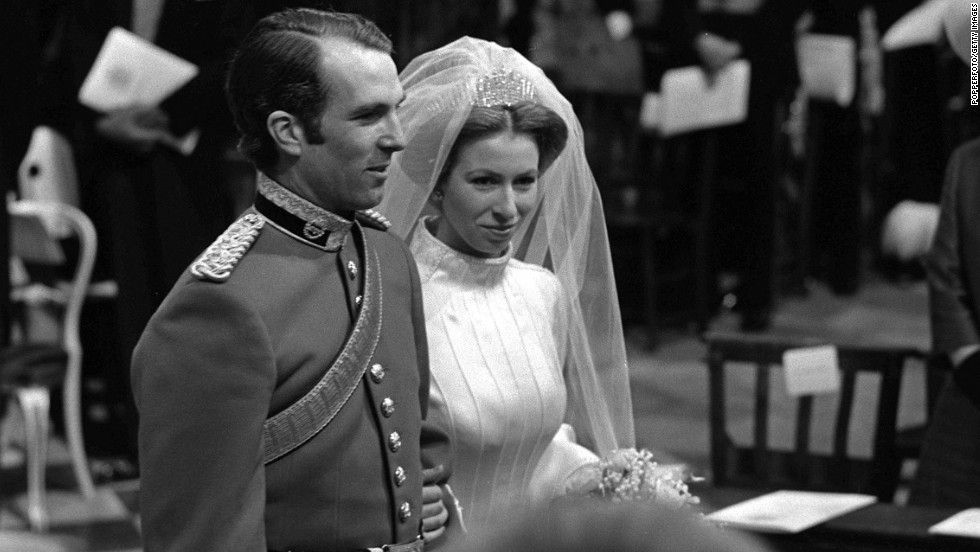 HRH Princess Anne and captain Mark Phillips stand together during their wedding service at Westminster Abbey in November 14, 1973.