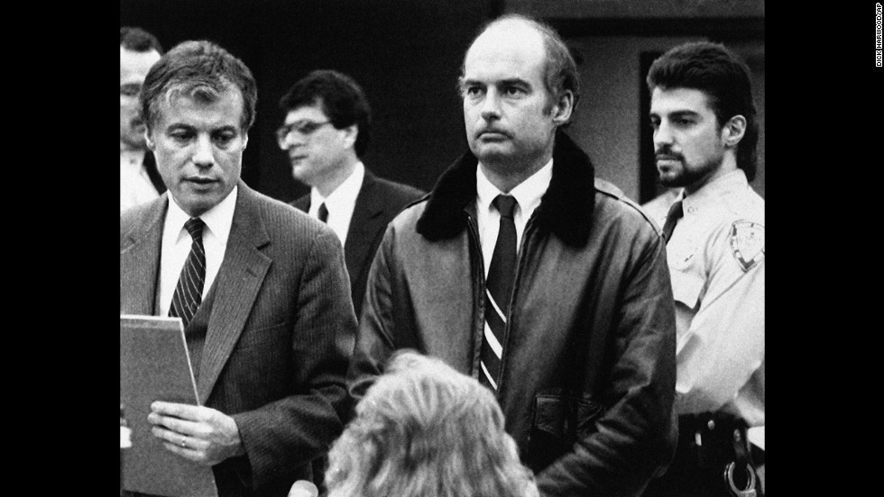 Capt. Joseph Hazelwood, center, stands with his attorney during his arraignment on fugitive charges stemming from the grounding of the Exxon Valdez. An Alaska jury  cleared him on a felony charge but he was convicted of negligent discharge of oil, a misdemeanor, for which he performed community service.