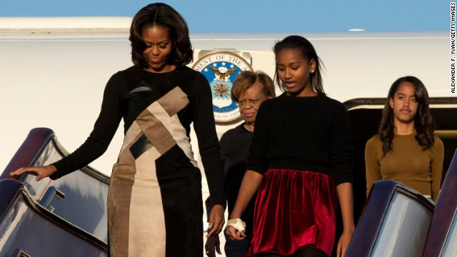 BEIJING, CHINA - MARCH 20:  First Lady Michelle Obama with her mother Marian Robinson, daughters Sasha Obama and Malia Obama arrives at Beijing Capital International Airport on March 20, 2014 in Beijing, China. The first lady arrived in Beijing with her mother, Marian Robinson, and daughters to kick off a six-day tour where she will focus on education and cultural exchange. (Photo by Alexander F. Yuan/Getty Images)