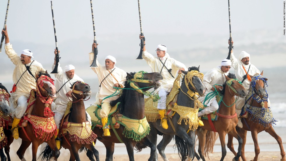 Moroccan horsemen ride along Essaouira's beach<br />at the 2012 Gnaoua World Music Festival.