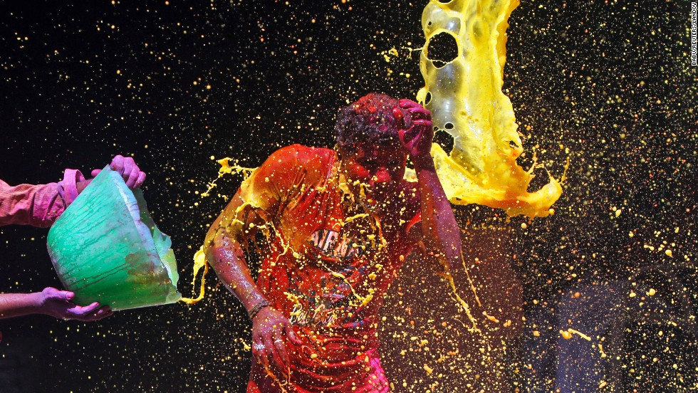 "A man has colored water splashed onto him during <a href=""http://www.cnn.com/2014/03/17/asia/gallery/holi-2014/index.html"">Holi celebrations</a> in Chennai, India, on Monday, March 17. The Holi festival of colors is a Hindu celebration of the arrival of spring."