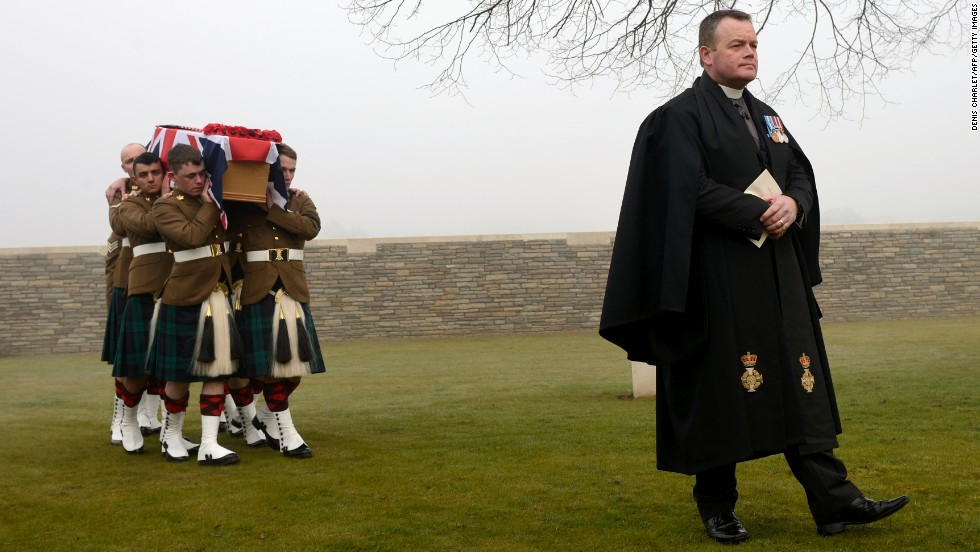 Soldiers carry the flag-draped casket of British soldier William McAleer during McAleer's funeral Friday, March 14, in Loos-en-Gohelle, France. Nearly 100 years after they were killed in the Battle of Loos during World War I, 20 British soldiers were buried at Loos British Cemetery. Their remains were found in 2010.