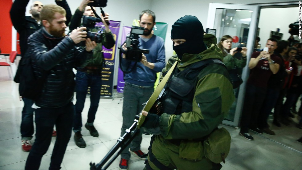 "An armed man leaves the Moscow Hotel in Simferopol, Crimea, on Saturday, March 15. Russian President Vladimir Putin announced the annexation of Ukraine's Crimea region a couple of days after voters in the semi-autonomous territory approved a referendum on <a href=""http://www.cnn.com/2014/02/24/world/gallery/ukraine-in-transition/index.html"">separating from Ukraine</a>."