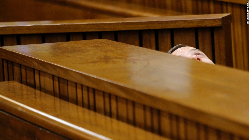 "Oscar Pistorius leans back after applying eye drops in court Friday, March 14, during <a href=""http://www.cnn.com/2014/03/03/africa/gallery/pistorius-2014-trial/index.html"">his trial in Pretoria, South Africa</a>. Pistorius, the first double amputee runner to compete in the Olympics, is accused of intentionally killing his girlfriend, Reeva Steenkamp, in February 2013. Pistorius has pleaded not guilty to murder and three other weapons charges."