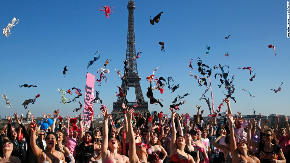 Women toss bras in the air near the Eiffel Tower in Paris on Sunday, March 16. It was part of an annual charity event to promote breast cancer awareness.