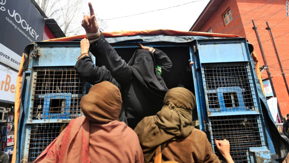 "A member of the Jammu Kashmir Mass Movement shouts slogans from a police van after being detained during a protest in Srinagar, India, on Thursday, March 20. <a href=""http://www.cnn.com/2014/03/14/world/gallery/week-in-photos-0314/index.html"">See last week in 26 photos.</a>"
