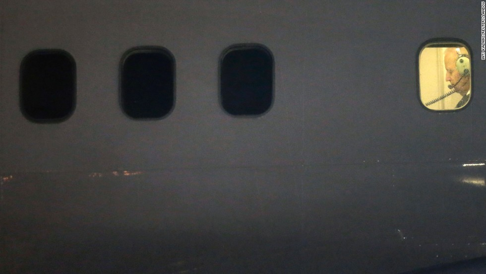 U.S. Vice President Joe Biden is seen in a plane window after landing in Vilnius, Lithuania, on Tuesday, March 18.