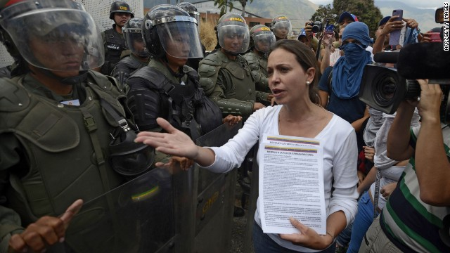 Opposition deputy Maria Corina Machado talks to members of the National Guard during a protest against Venezuelan President Nicolas Maduro, in Caracas on March 16, 2014.