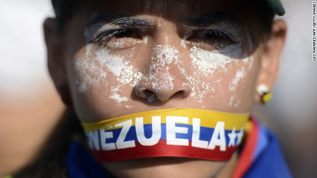 An anti-government activist demonstrates against Venezuelan President Nicolas Maduro in Caracas, on March 20, 2014.