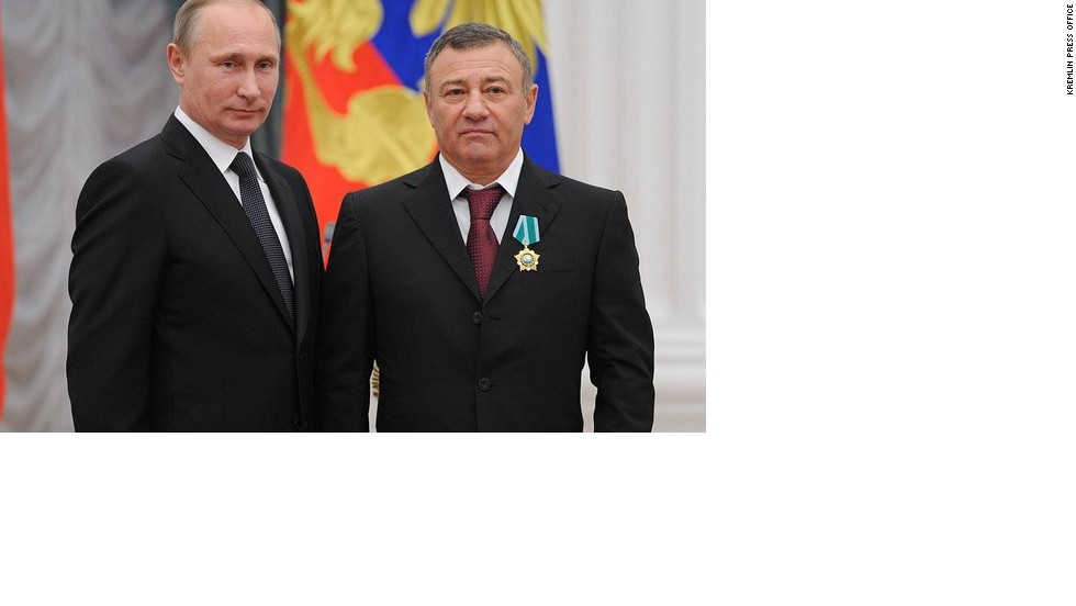 The Rotenberg brothers have close links with Putin, having been his sparring partners in judo training for years. Boris is the president of Dynamo Moscow football club, while Arkady (pictured with Putin here) is an executive for Dynamo's ice-hockey club.