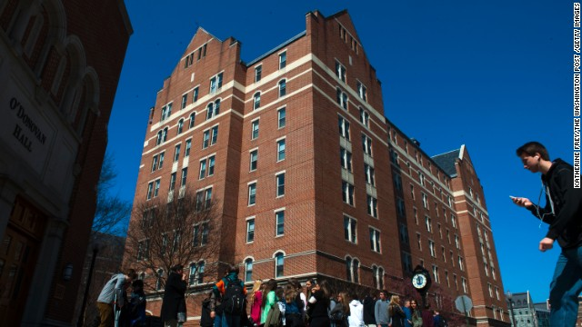 Students on Thursday stand outside McCarthy Hall, a Georgetown University dormitory where a student said he made ricin.
