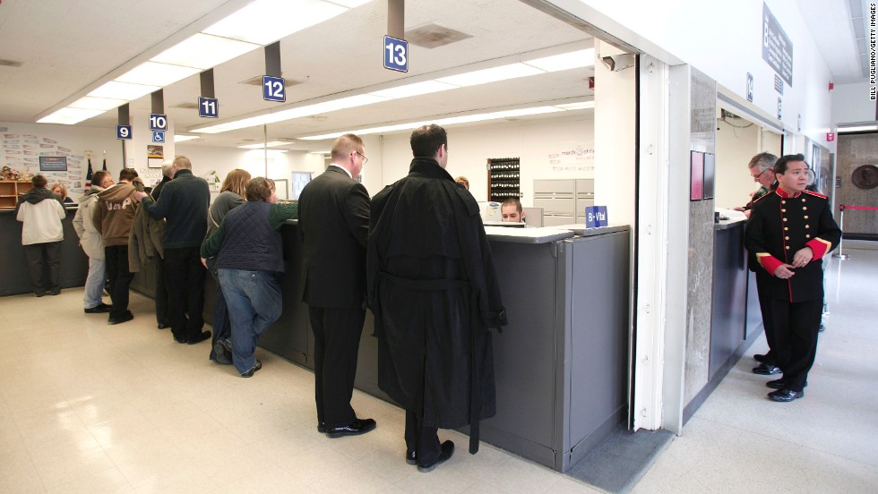 Same-sex couples get their marriage licenses at the Oakland County Courthouse in Pontiac, Michigan, on March 22, 2014, a day after a federal judge overturned Michigan's ban on same-sex marriage.