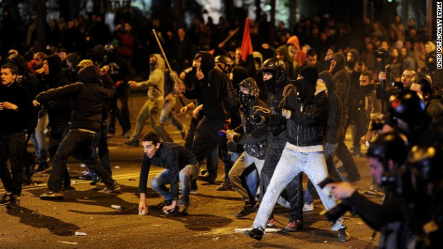 Demonstrators confront police in Madrid as an anti-austerity protest ends in clashes.