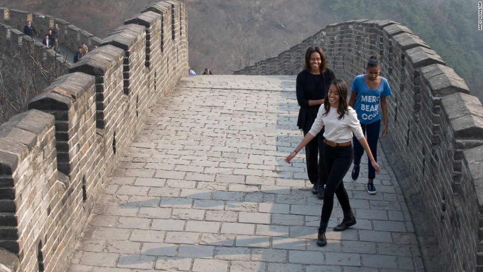 Obama, Malia and Sasha walk up the Mutianyu section of the Great Wall of China on Sunday, March 23.