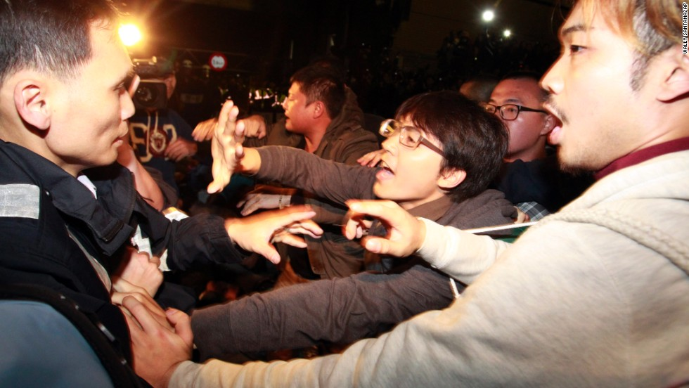 Student protesters clash with police in Taipei on March 24.