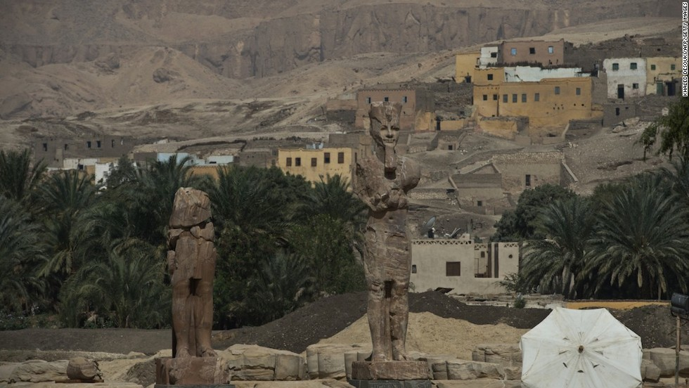 Two colossal statues of Pharaoh Amenhotep III were unveiled by archaeologists Sunday -- after being moved to their original sites and restored -- in the funerary temple of the king, on the west bank of the Nile in Luxor, Egypt.