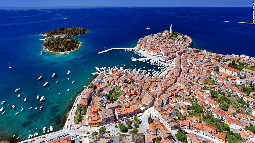 "<strong>Rovinj, Istria</strong><br />On the western coast of Istria, Rovinj may be one of the last remaining original fishing ports on the Mediterranean. The old town juts onto an egg-shaped peninsula riddled with steep cobbled streets and piazzas. The Church of St. Euphemia (Crkva Sveta Eufemija) is the largest monument in the city. Its tower is a distinguished part of the old town's vista.<em><br /><a href=""http://www.tzgrovinj.hr/"" target=""_blank"">Rovinj</em></a><em>, Istria; +385 52 811 566</em>"