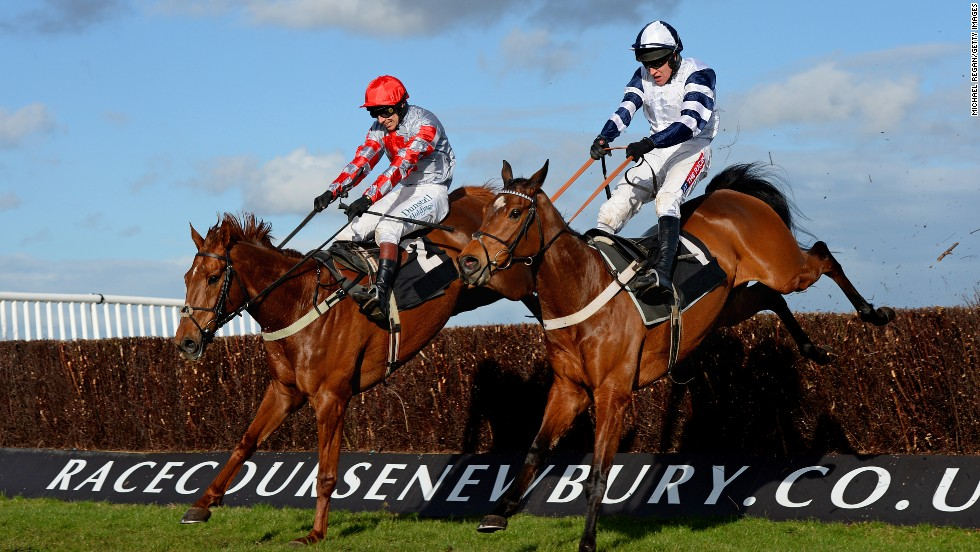 Barry Geraghty rides Thanks for Coming, right, to victory in the Oakley Coachbuilders Novices' Limited Handicap Chase, which was held Friday, March 21, in Newbury, England.