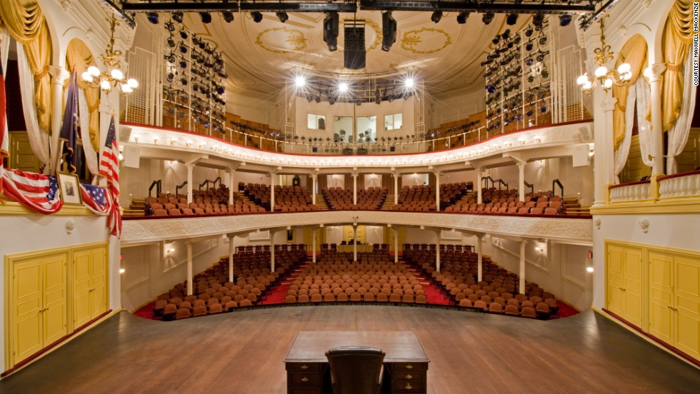 "John Wilkes Booth entered the theater box (on left) where Abraham Lincoln was attending a performance of ""Our American Cousin"" and shot him in the back of the head. Ford's Theater is now a museum and education center, as well as a playhouse."