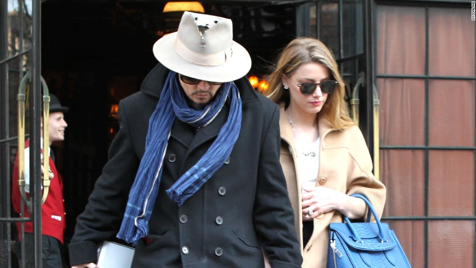 If you look closely you'll see Amber Heard's sparkling engagement ring as she steps out with her husband-to-be, Johnny Depp, on March 22.