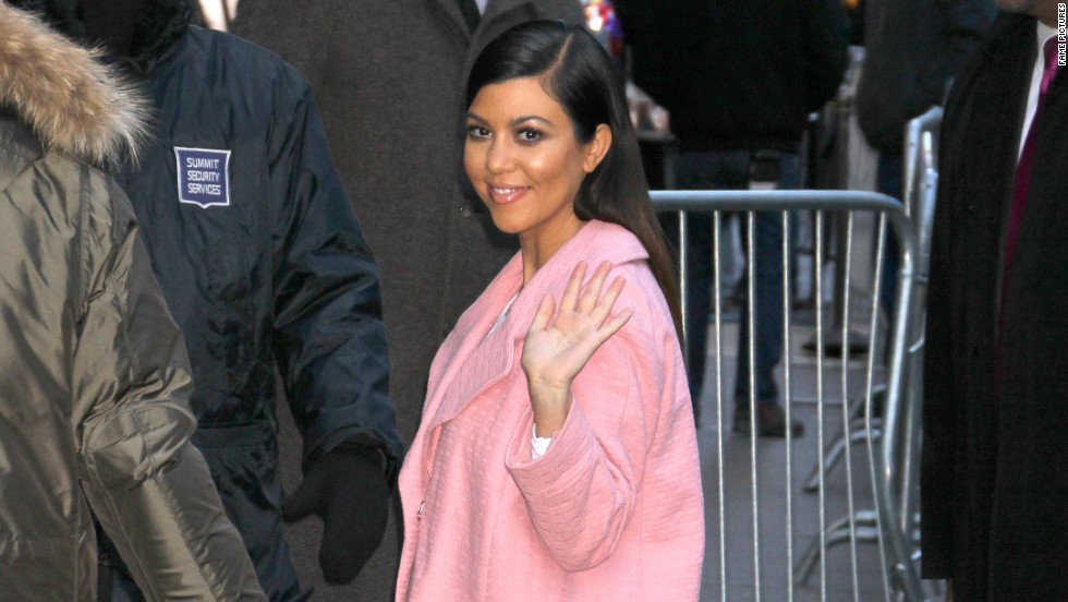 "Kourtney Kardashian thinks pink when she arrives at ""Good Morning America"" on March 24."