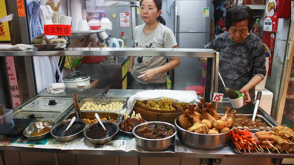 "Indoor corridors beneath the Tai On Building have been turned into a food market open every evening till late, with vendors serving curry fish balls, imitation shark's fin soup and ""cart noodles.""<a href=""http://travel.cnn.com/hong-kong/none/40-things-eat-hong-kong-coronary-arrest-820489""> </a>"