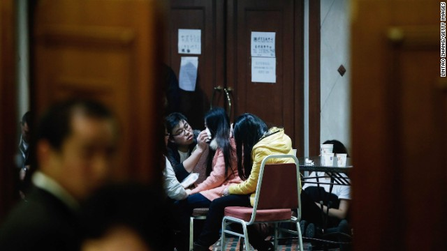 Family members of passenger sfrom the missing Malaysia Airlines flight MH370 reacts at Lido Hotel on March 24, 2014 in Beijing, China.