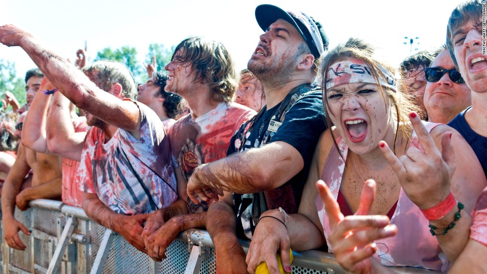 Devoted fans revel in the opportunity to be covered in fake blood at a Gwar performance.