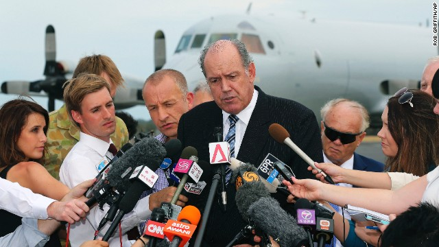 Australia's Defense Minister David Johnston speaks to the media about developments in the search for the missing jet in Perth, Australia, on March 25.