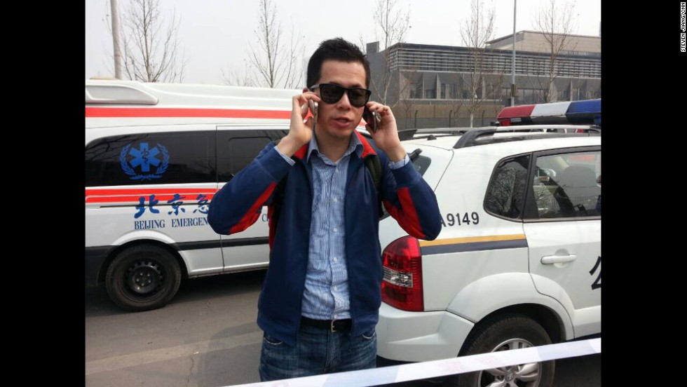 """On two phones in between a police car and an ambulance: coordinating live coverage from Beijing as families of MH370 protest in front of the Malaysian embassy.""  By CNN's Steven Jiang, Beijing, March 25.  Follow Steven on Instagram at <a href=""http://instagram.com/stevencnn"" target=""_blank"">instagram.com/stevencnn</a>."