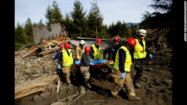 A search and rescue team carries the body of a victim on March 24.