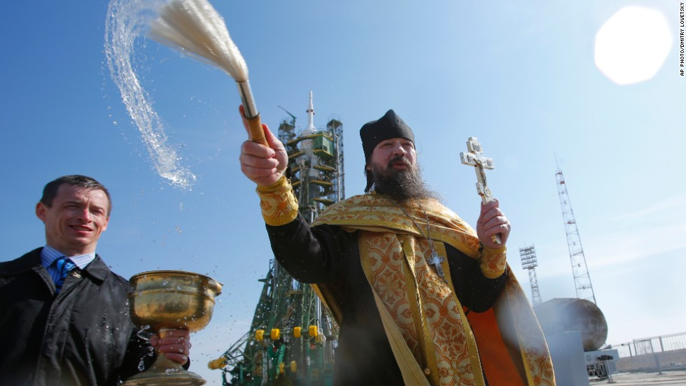 MARCH 26 - BAIKONUR, KAZAKHSTAN: An Orthodox priest conducts a blessing service in front of the Soyuz TMA-12M spacecraft at the Baikonur Cosmodrome. The start of the new Soyuz mission to the International Space Station (ISS) is scheduled for March 27.