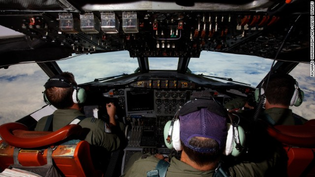 This picture taken on March 24, 2014 shows crew members on board an RAAF AP-3C Orion whilst transiting at high altitude on what was to be an 11 hour search mission for missing Malaysia Airways flight MH370 over the Indian Ocean. The air and sea search for Malaysia Airlines flight MH370 that crashed in the Indian Ocean was suspended on March 25 due to gale force winds, rain and big waves, the Australian Maritime Safety Authority said. AFP PHOTO / POOL / RICHARD WAINWRIGHT        (Photo credit should read RICHARD WAINWRIGHT/AFP/Getty Images)