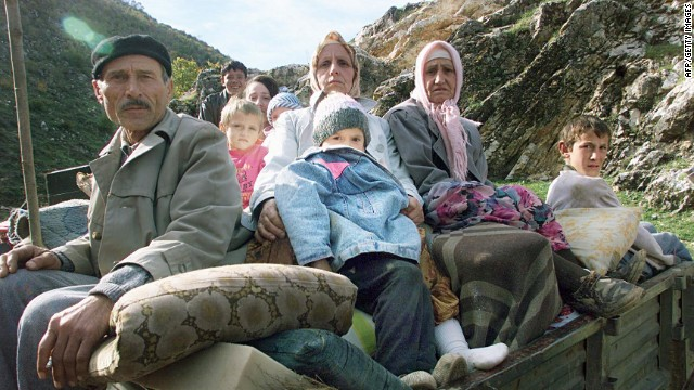 Displaced ethnic Albanians leave their camp October 29, 1998, near Komorane, Kosovo.