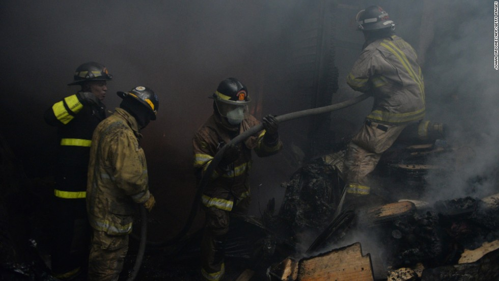 Firefighters attempt to put out the blaze.