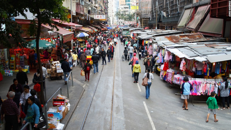 "Any tram heading to North Point runs through Chun Yeung Street, which features one of the most interesting <a href=""http://travel.cnn.com/hong-kong/shop/city-essentials/best-wet-markets-563207"">wet markets in Hong Kong</a>. The tram runs right through the middle of the market. This shot was taken from the front row seats on the tram's upper deck."