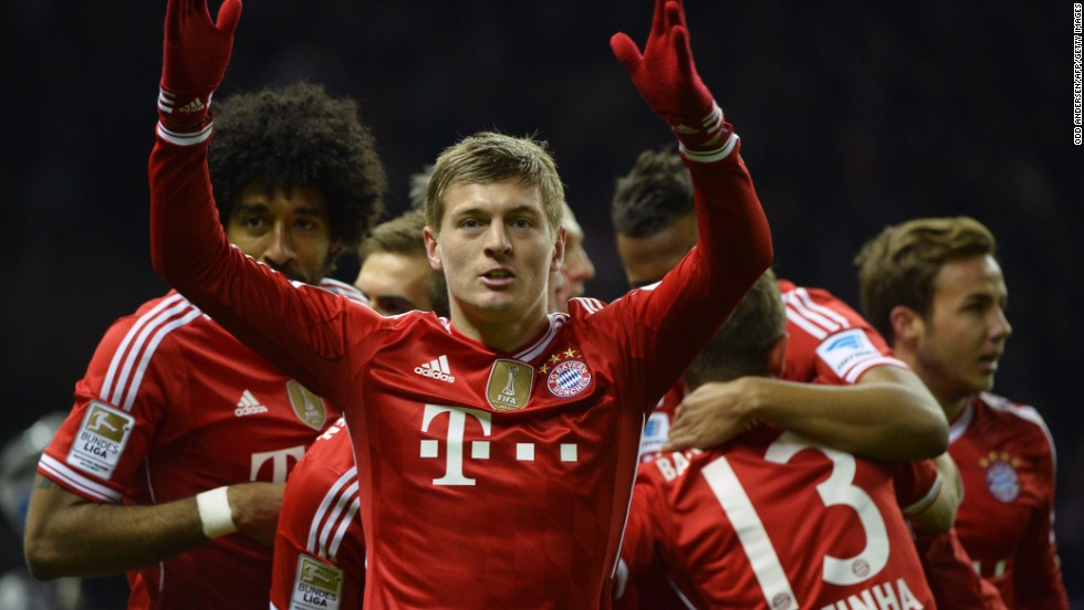 Toni Kroos (center) celebrates scoring Bayern Munich's opening goal against Hertha Berlin which helped seal a 24th Bundesliga title for the Bavarians.