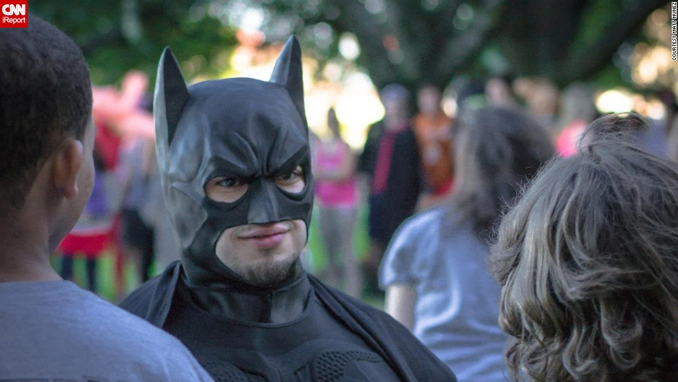 "Austin, Texas resident <a href=""http://ireport.cnn.com/docs/DOC-1111420"">Eli Vizcaino</a>, seen here dressed as Batman, credits the character with helping him ""find his voice."" Vizcaino had a speech impediment as a child, and when he read Batman stories aloud as therapy, they freed his imagination."