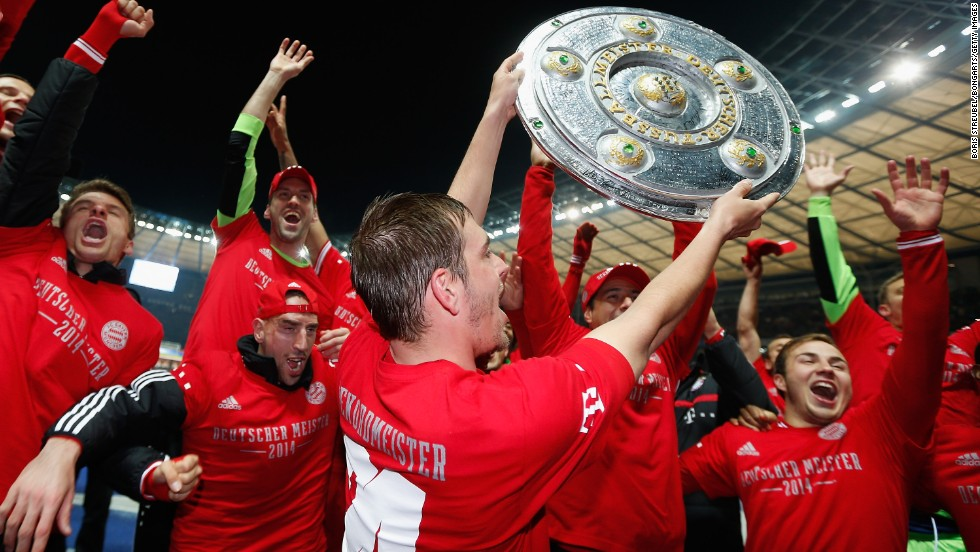 Bayern Munich's players celebrate with a replica of Bundesliga championship trophy after clinching the title at the Olympic Stadium in Berlin.