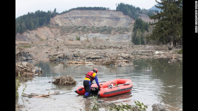 A search and rescue worker looks for survivors on Tuesday, March 25, in the aftermath of a landslide in Oso, Washington.