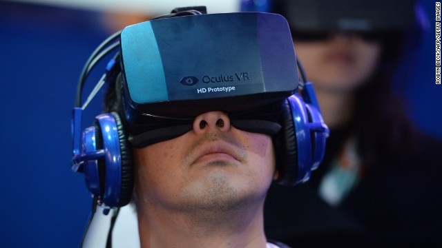 A gamer wearing an Oculus virtual-reality headset.