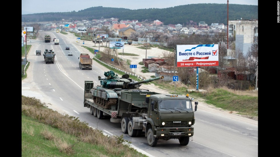 Ukrainian tanks are transported from their base in Perevalne, Crimea, on Wednesday, March 26. After Russian troops seized most of Ukraine's bases in Crimea, interim Ukrainian President Oleksandr Turchynov ordered the withdrawal of armed forces from the peninsula, citing Russian threats to the lives of military staff and their families.