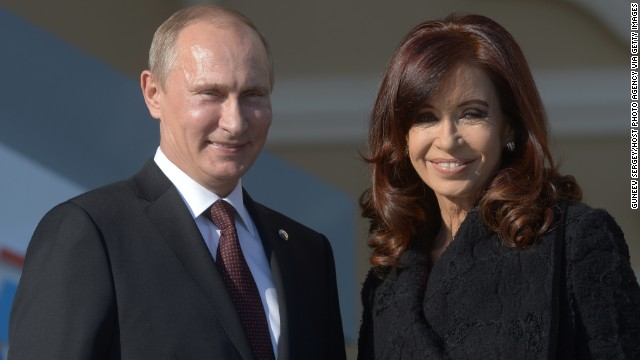 SAINT PETERSBURG - SEPTEMBER 05: In this handout image provided by Host Photo Agency, Russian President Vladimir Putin (L) and Argentine President Cristina Fernandez de Kirchner pose during an official welcome of G20 heads of state and government, heads of invited states and international organizations at the G20 summit on September 5, 2013 in St. Petersburg, Russia. The G20 summit is expected to be dominated by the issue of military action in Syria while issues surrounding the global economy, including tax avoidance by multinationals, will also be discussed during the two-day summit. (Photo by Guneev Sergey/Host Photo Agency via Getty Images)