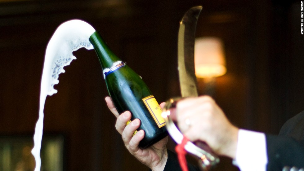 A saber is used to slice open champagne each evening at the St. Regis in Atlanta.